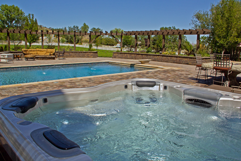 bullfrog spa overlooking pool